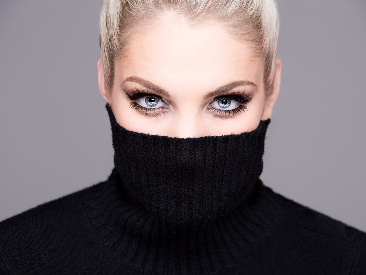 Woman Wearing Turtleneck with Thick Mascara