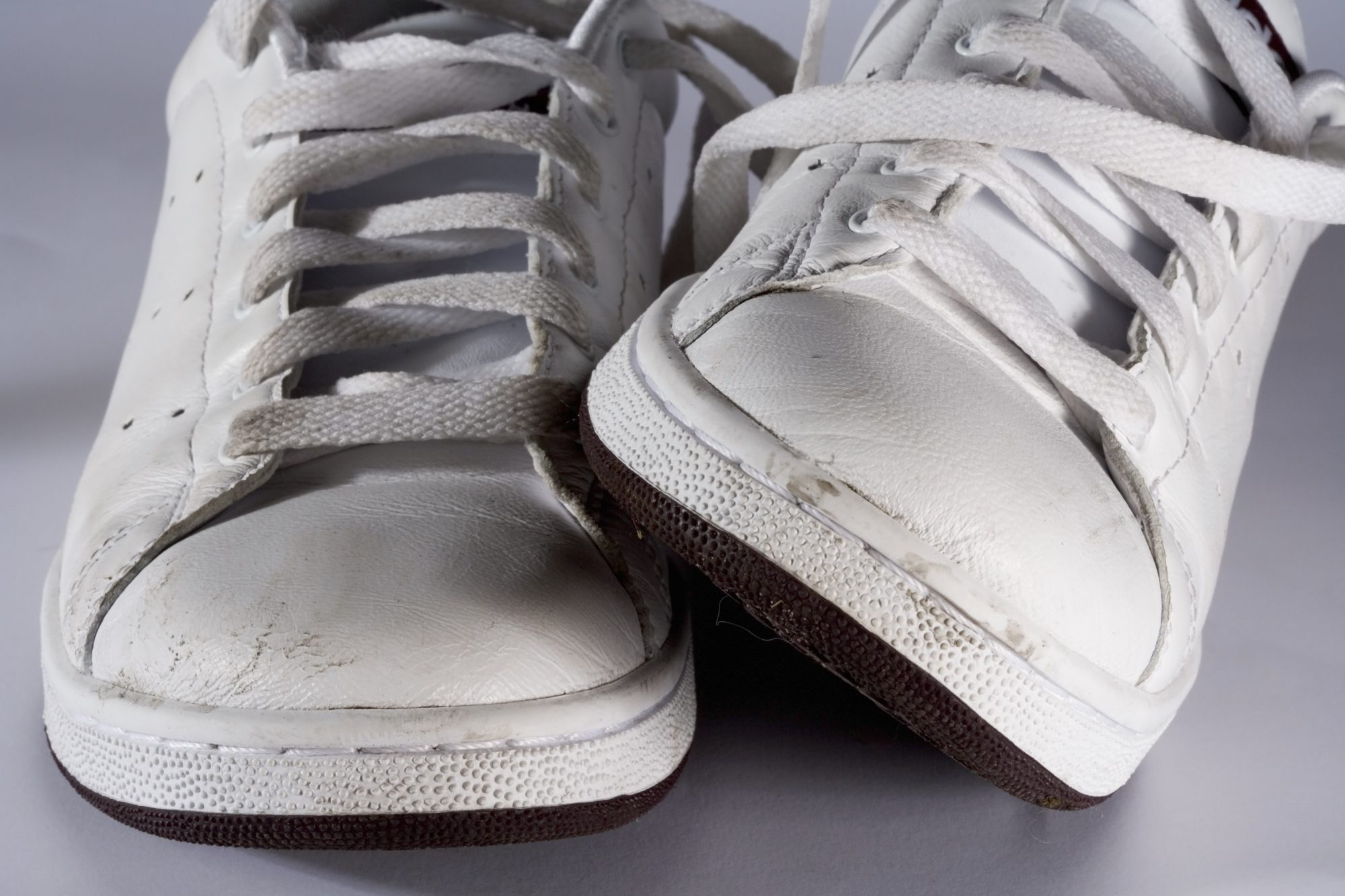 Worn White Sneakers