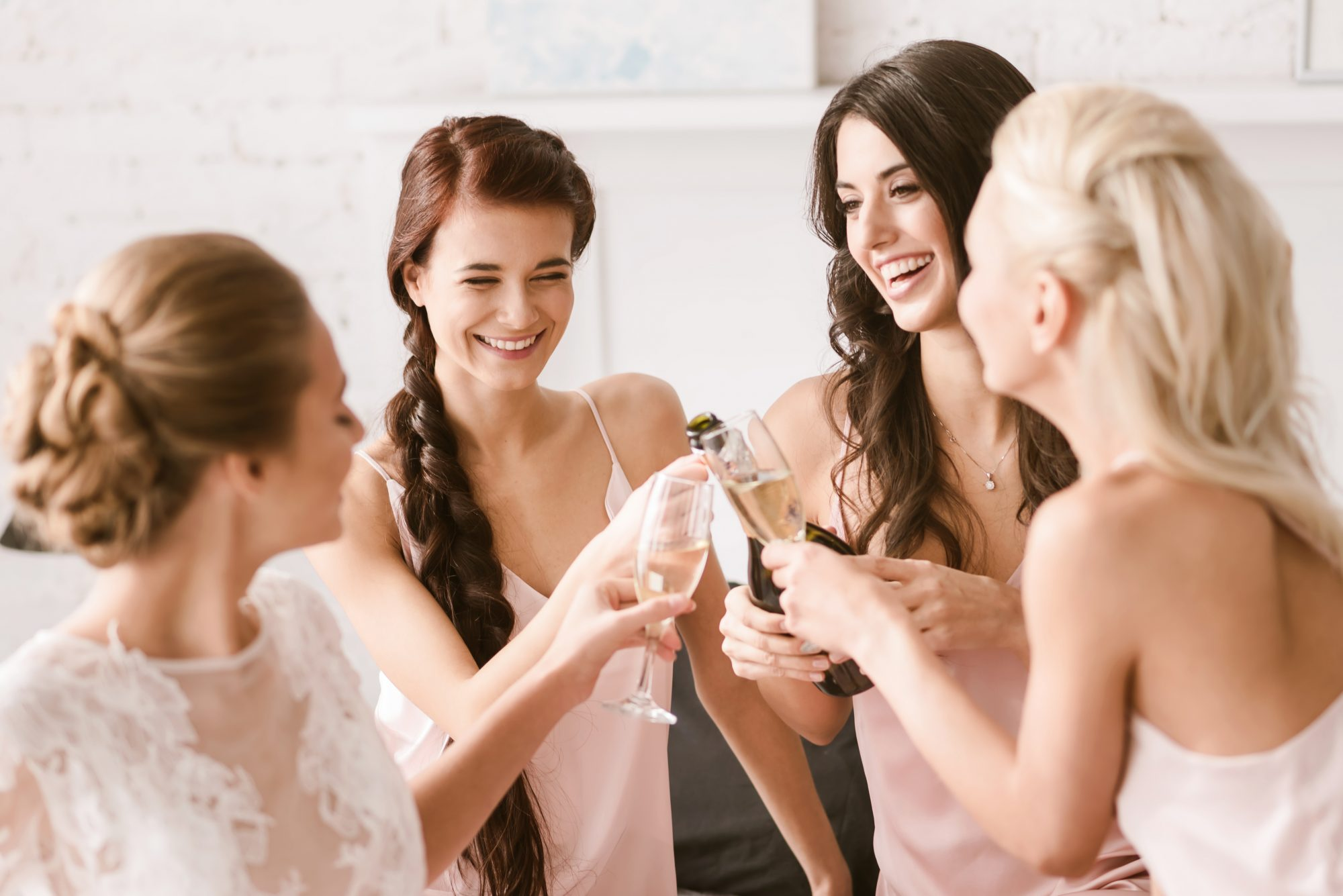 Bridesmaids Getting Ready, Laughing, and Toasting with Champagne
