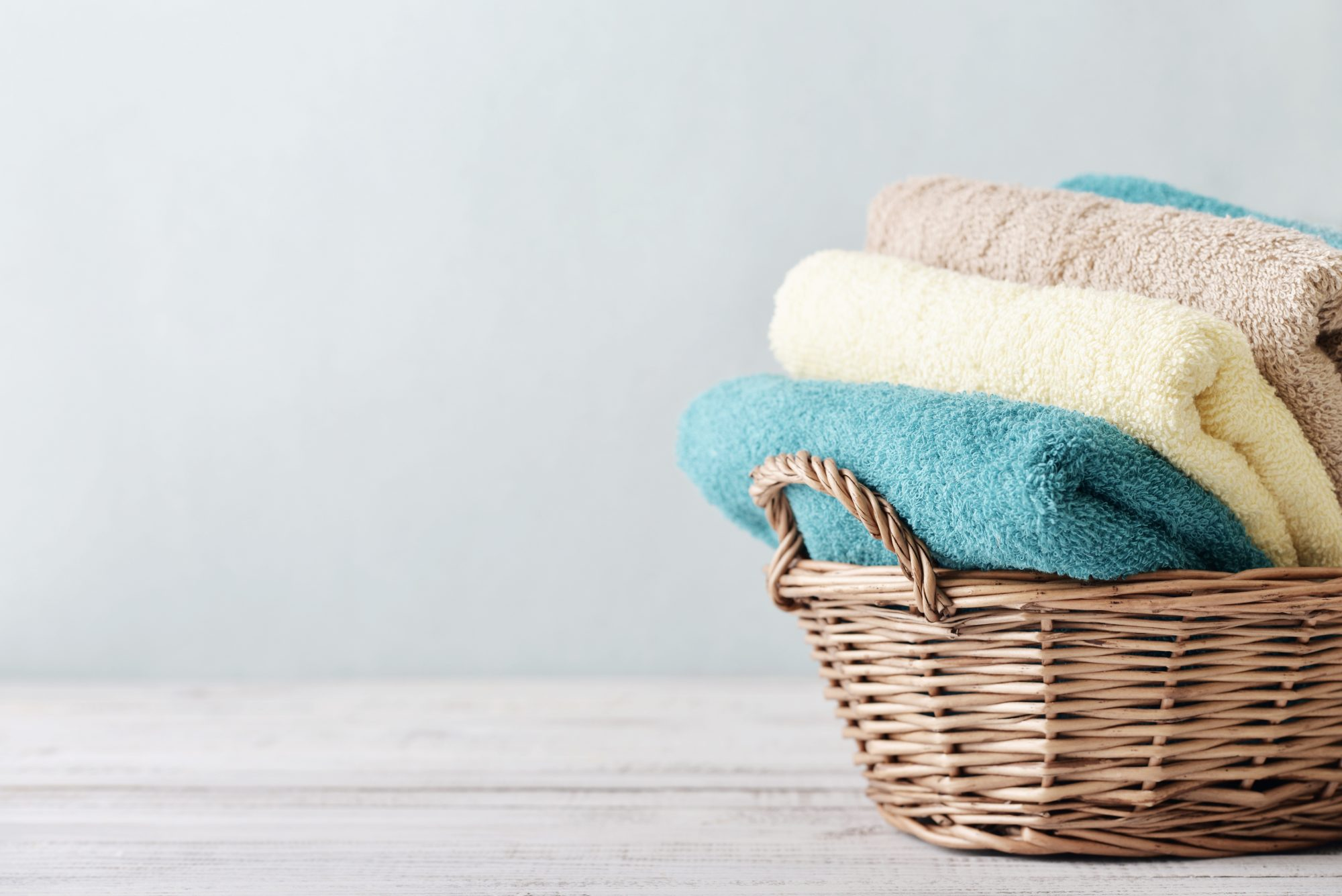 Folded Towels in Laundry Basket