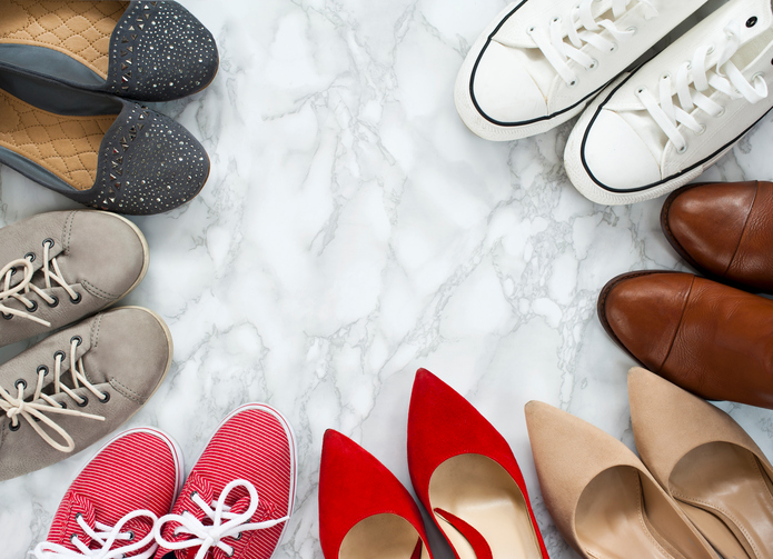 Fashion flatlay - variety of the colorful woman shoes on white, marble, elegant background.
