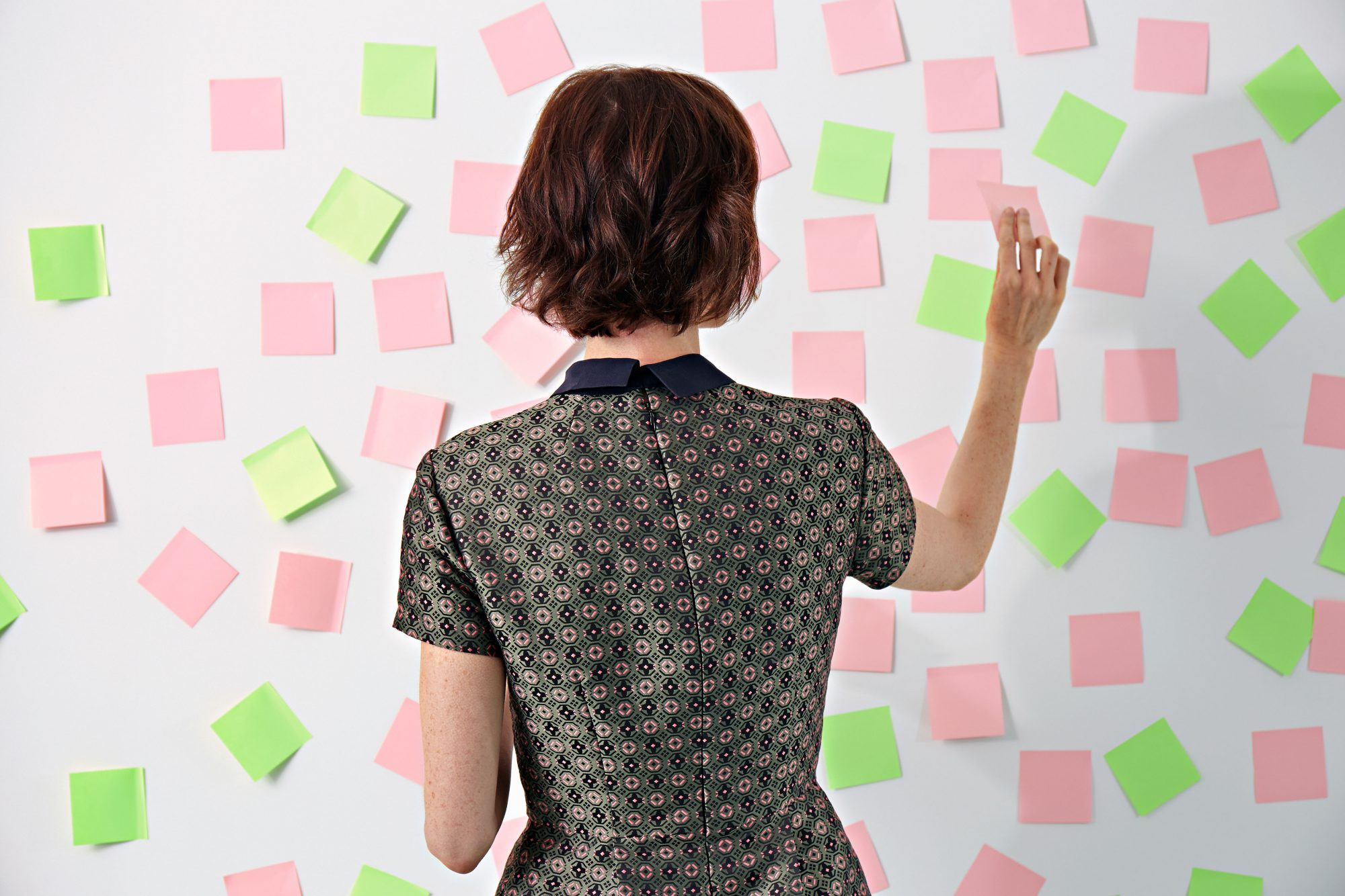 Woman Placing Sticky Notes on Board
