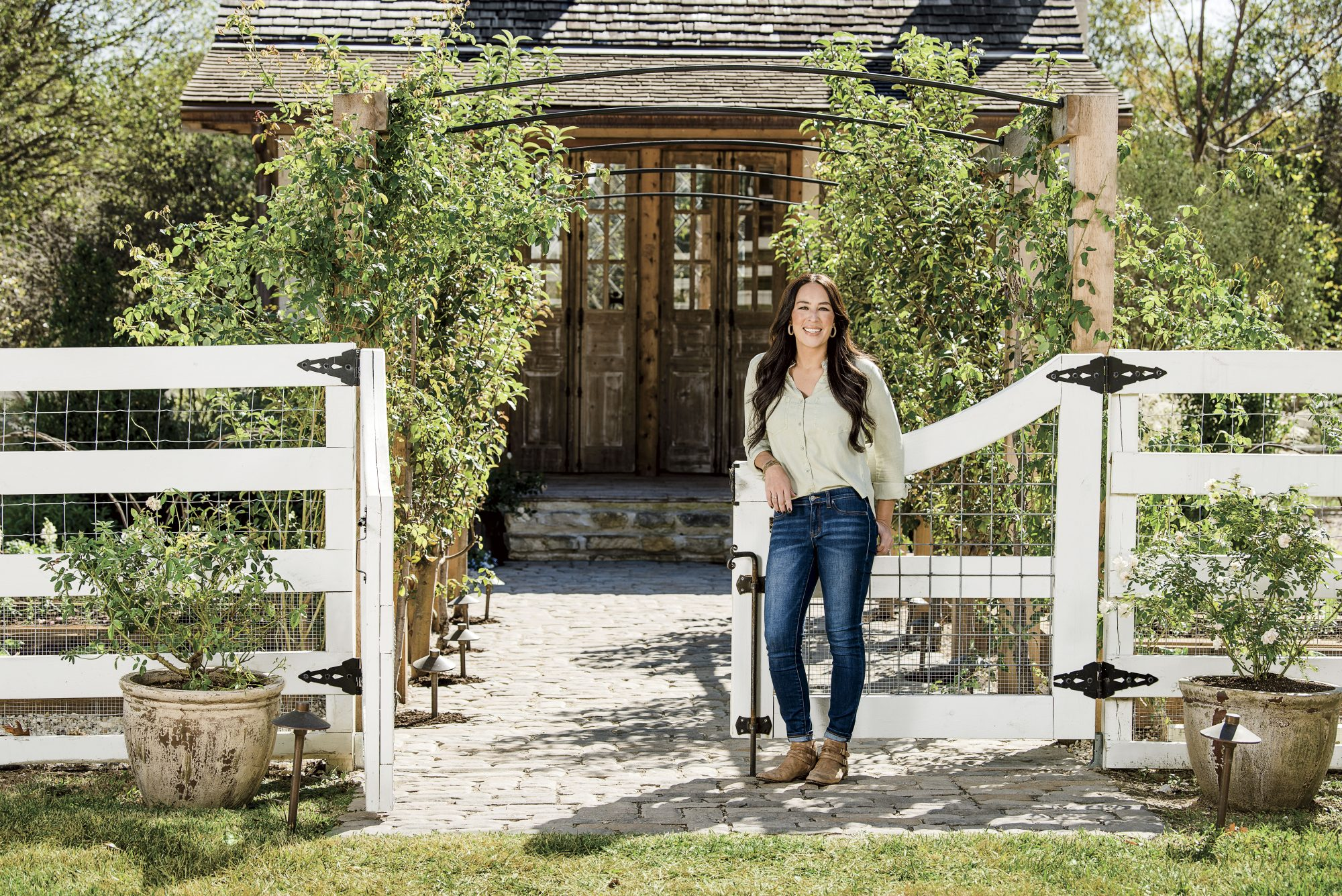 Joanna Gaines in front of Garden Shed