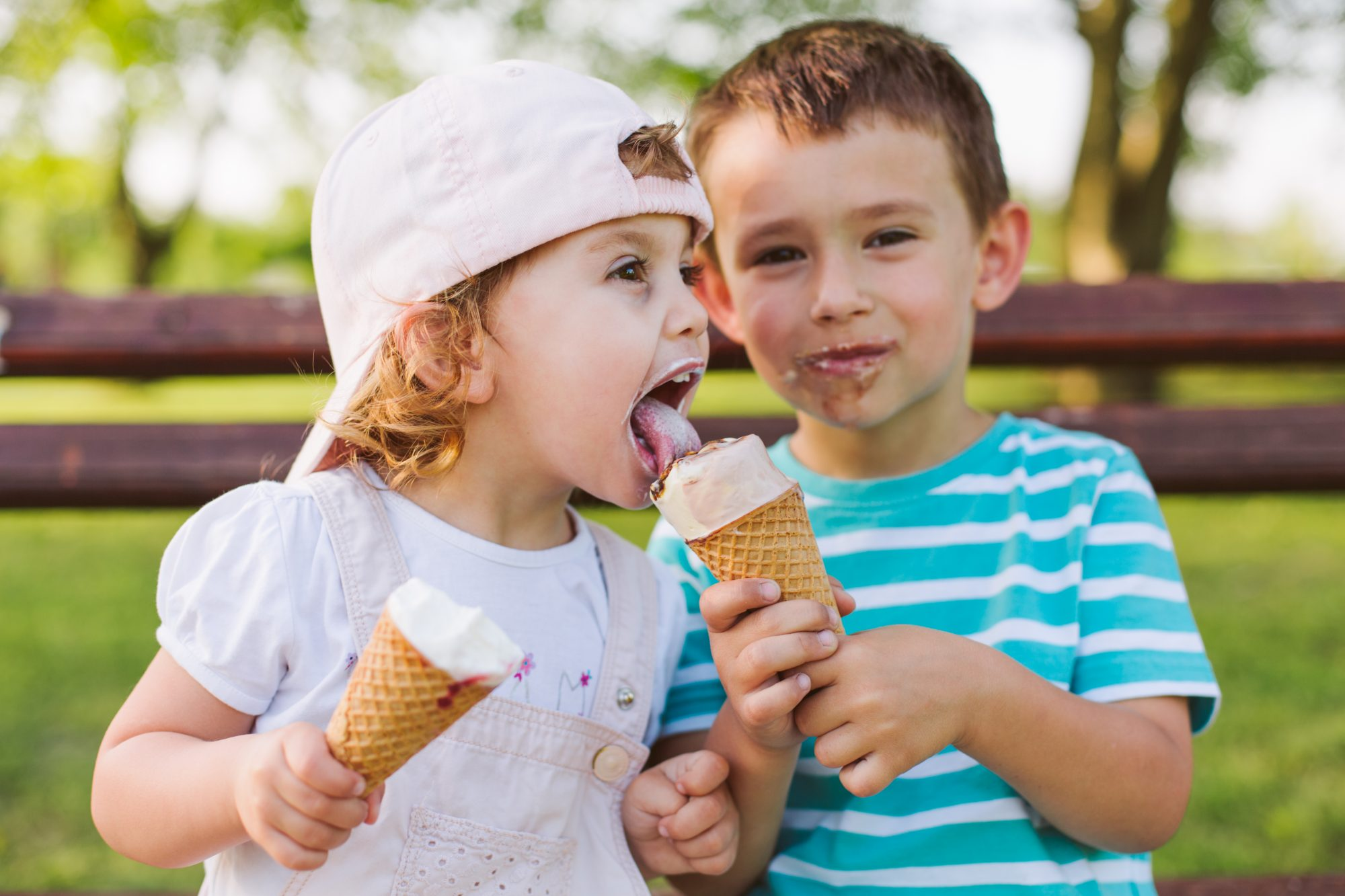 Little Boy Sharing Ice Cream with Sister