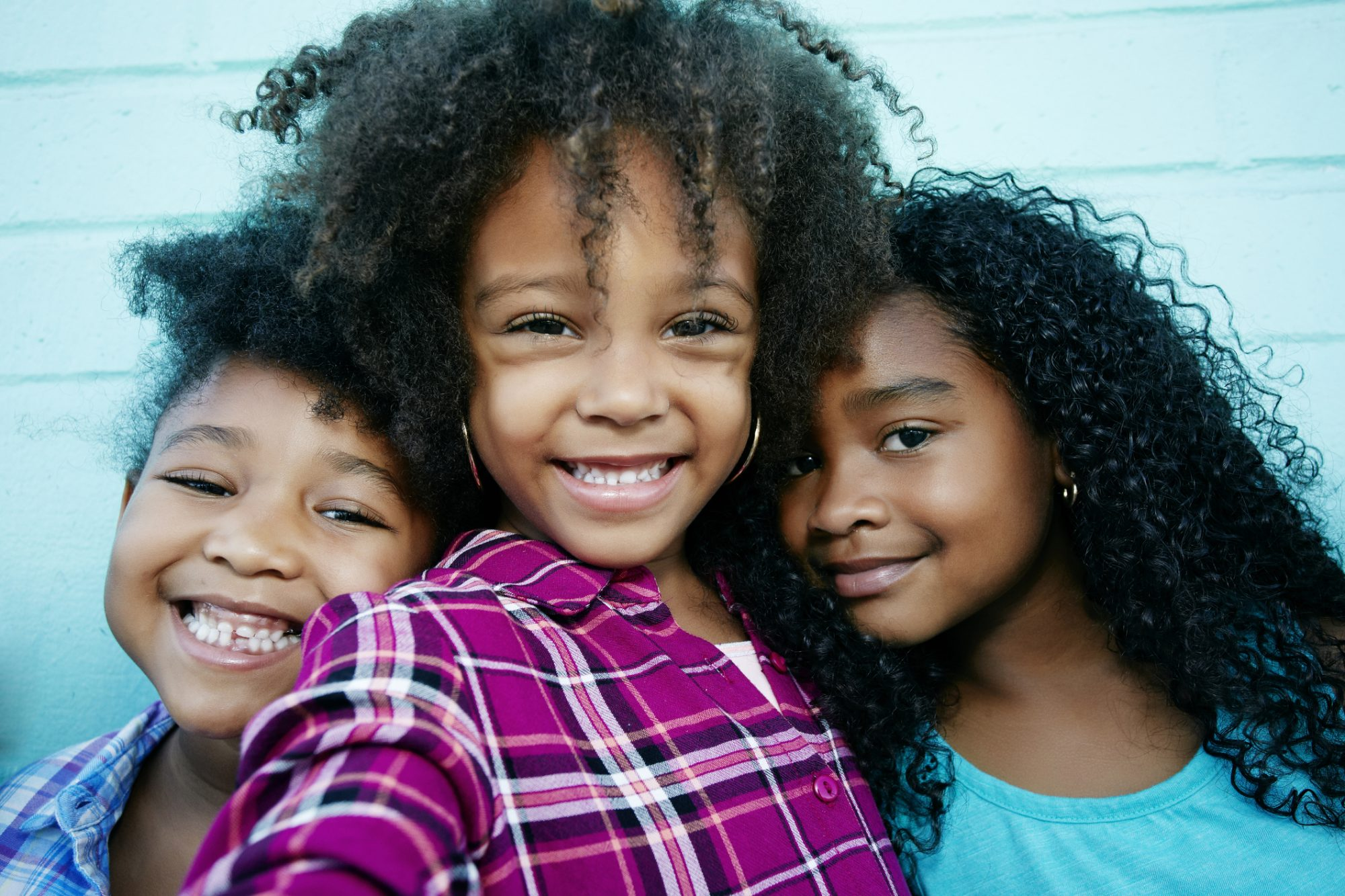 Three Young Sisters Smiling