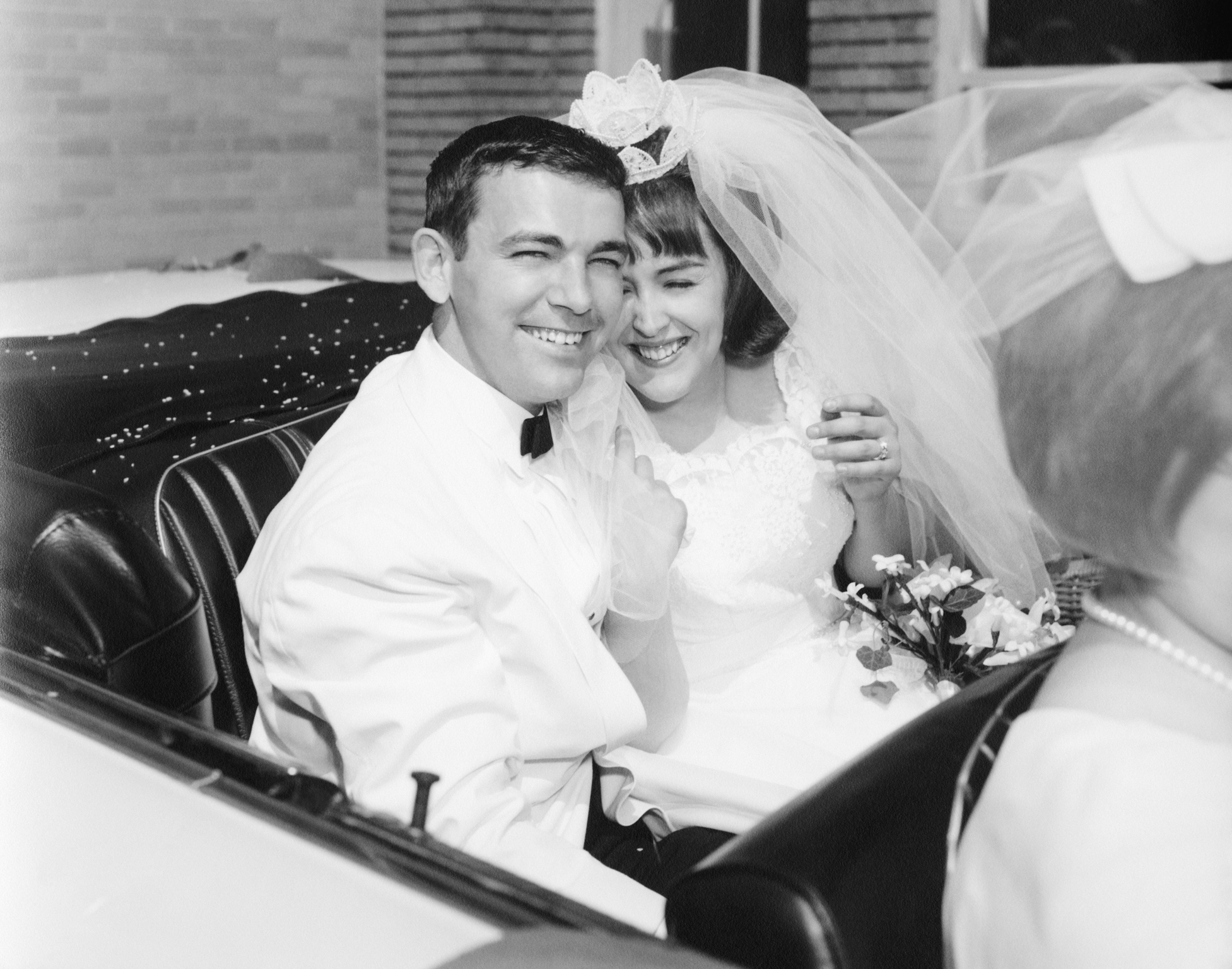Newlyweds Smiling in Car