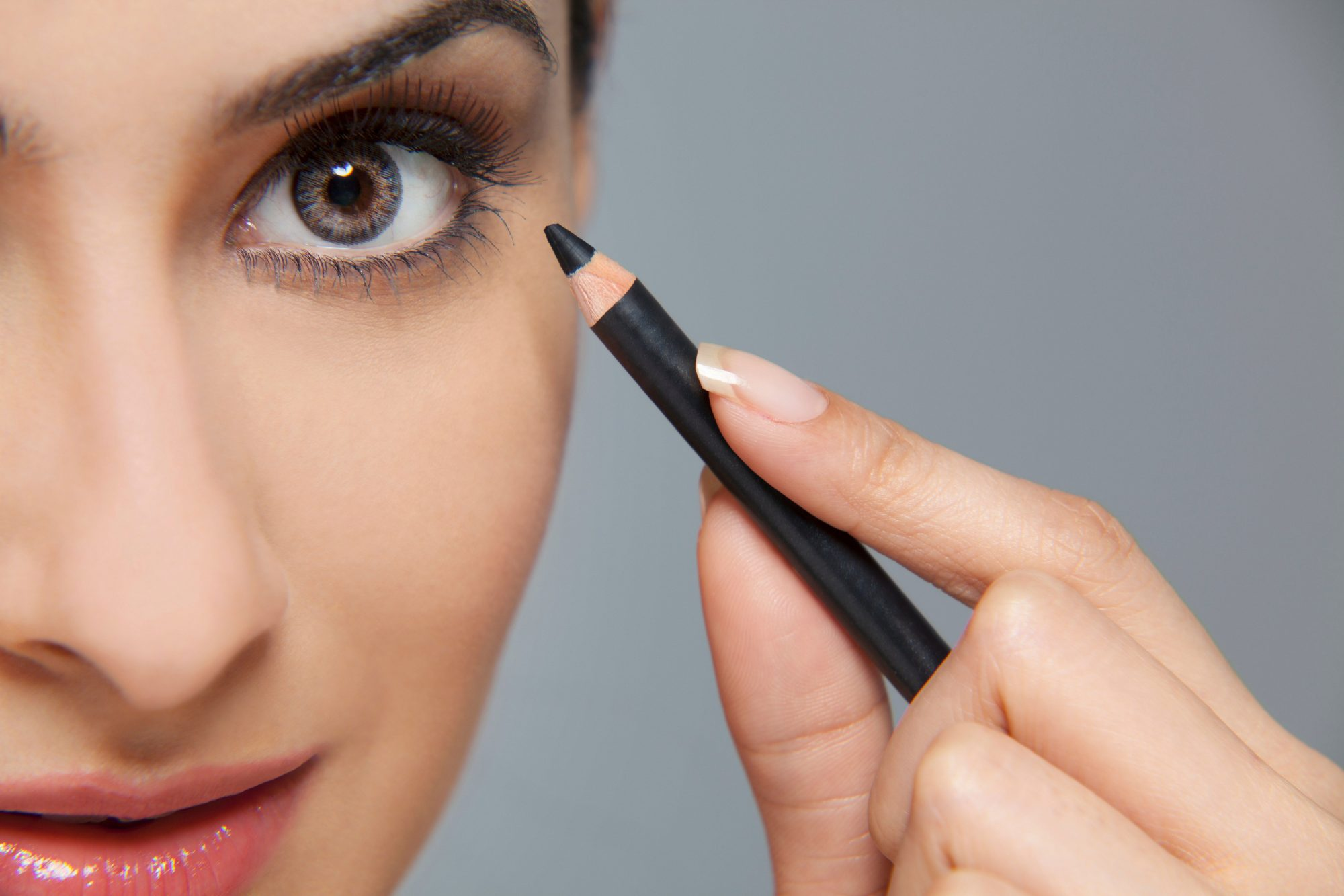 Woman with Eyeliner Pencil