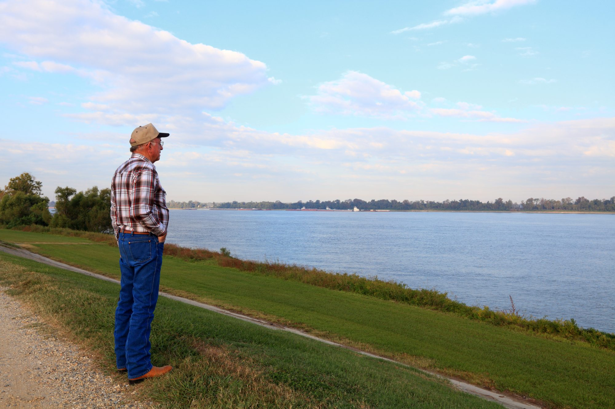 Man Looking at Louisiana Levee