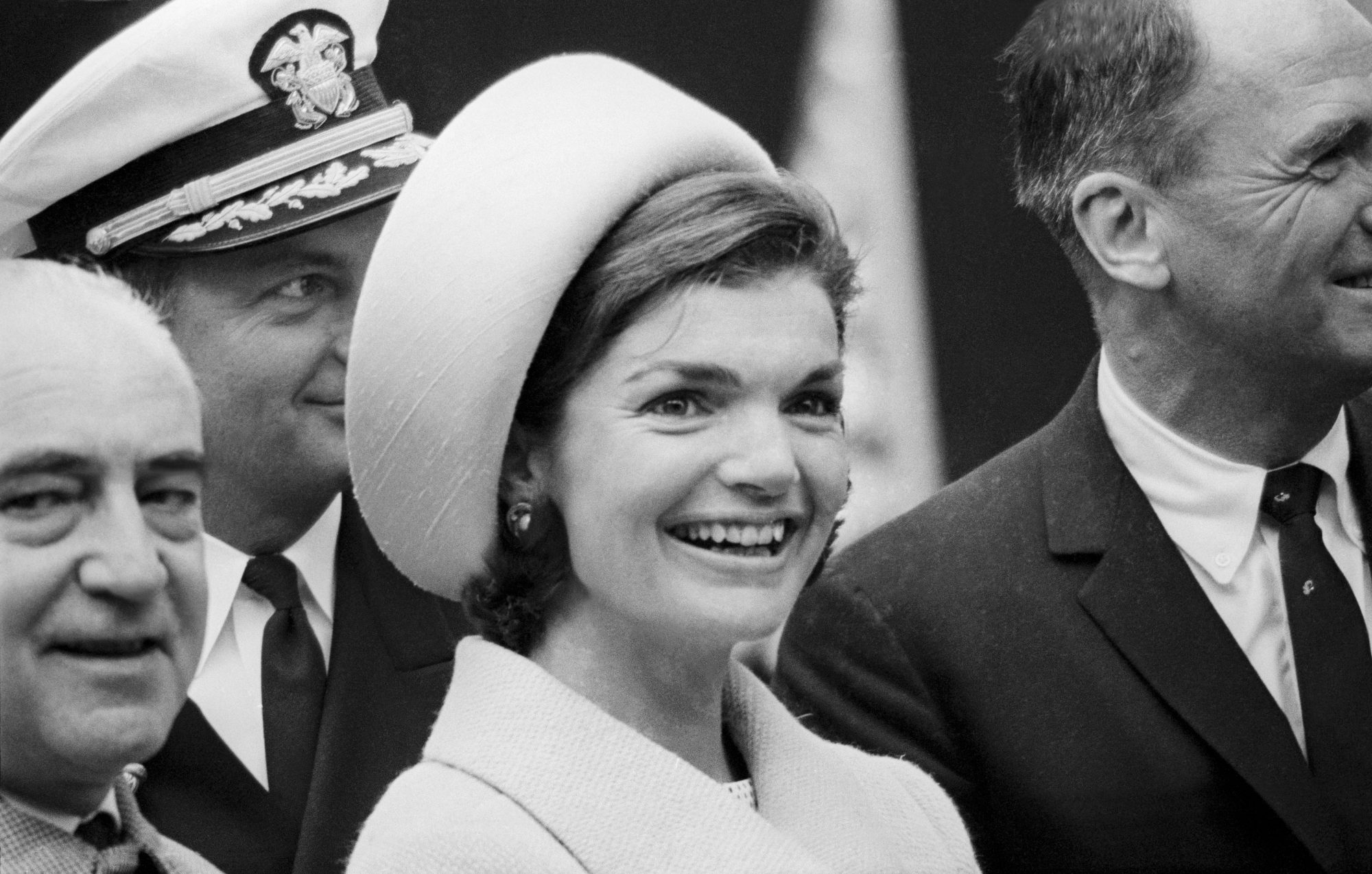 Jackie Kennedy in Pillbox Hat and Button Earrings