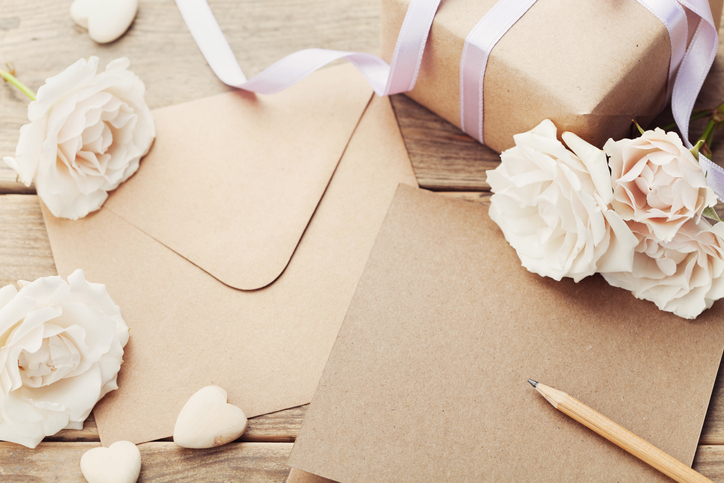 Envelope or letter, gift, paper card and roses. Greeting concept.