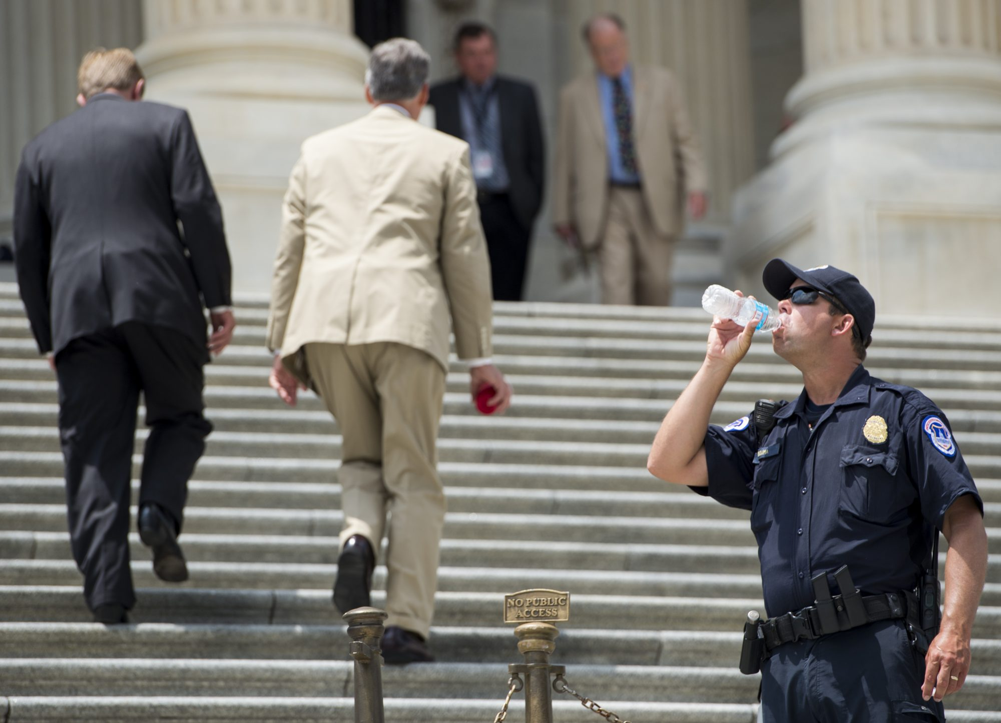 Police Officer Drinking Water