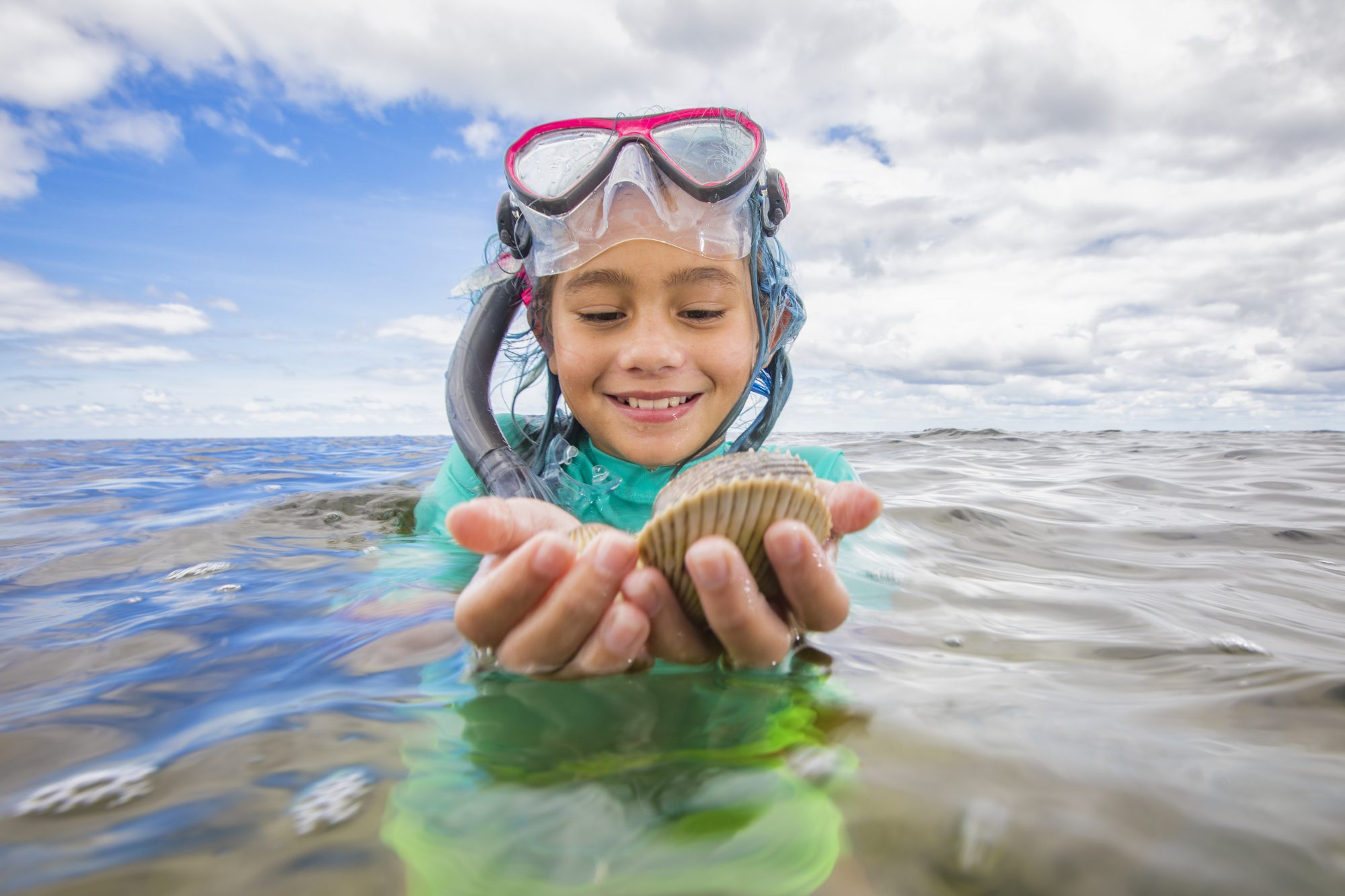 Girl Holding Live Scallop
