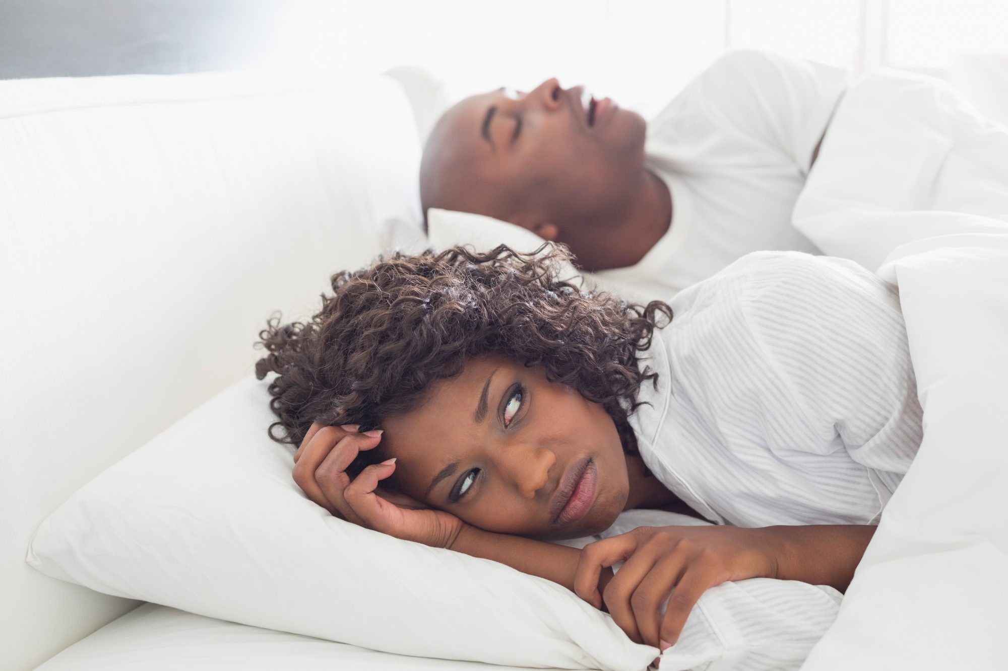 Woman Annoyed By Man Snoring