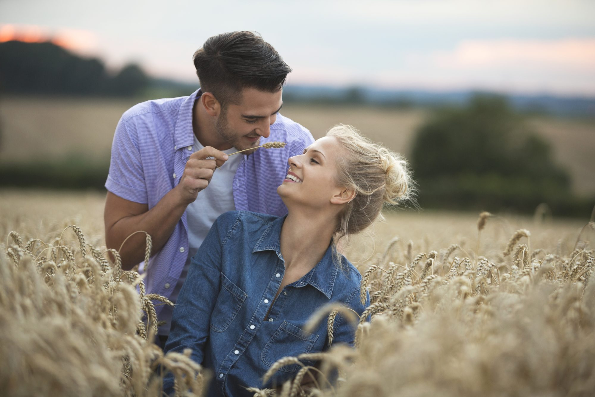 The Engagement Photo Shoot Trend We'd Like To Say Goodbye To_Getty Image of Young Couple in Wheat Field
