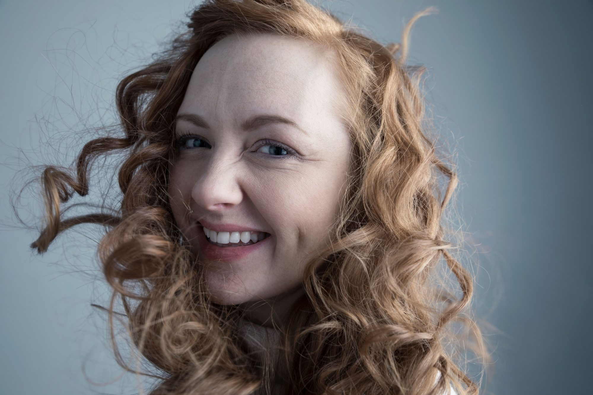 Woman with Red Hair Smiling