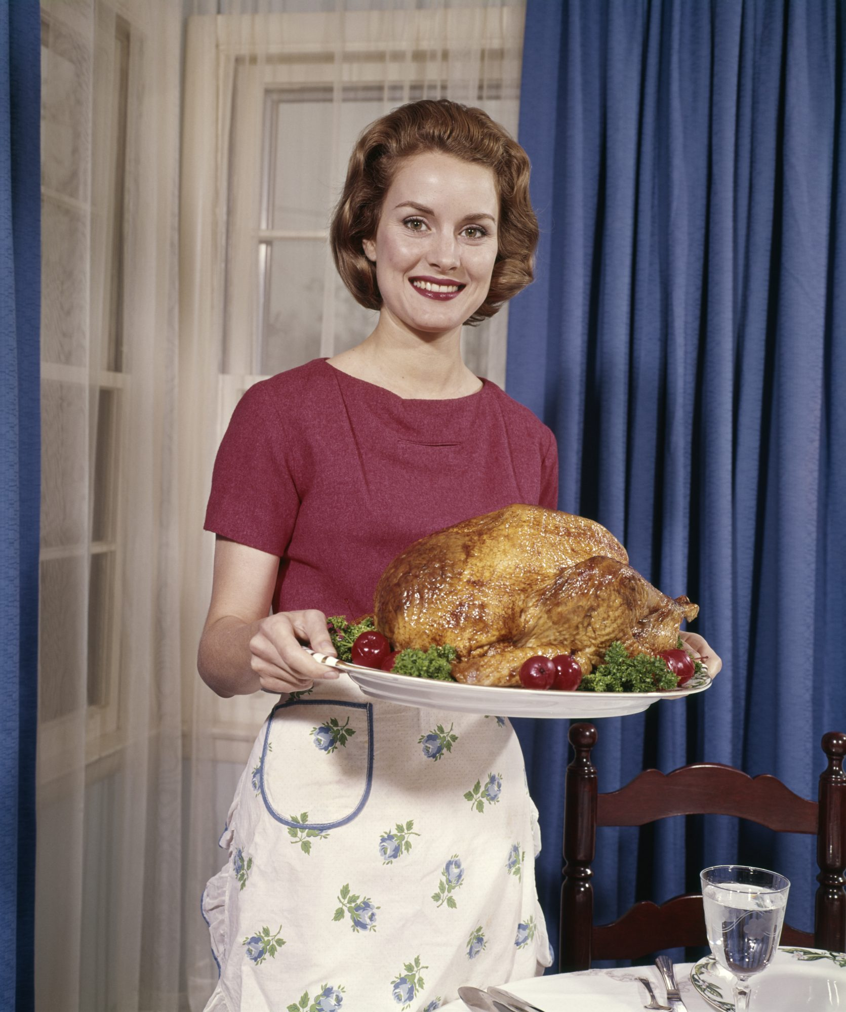 woman serving turkey