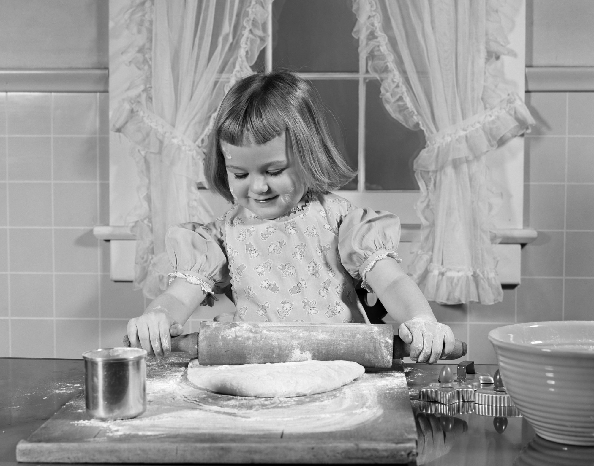 Young Girl Baking Rolling Out Dough