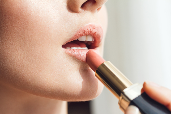 Beauty photo of applying lipstick