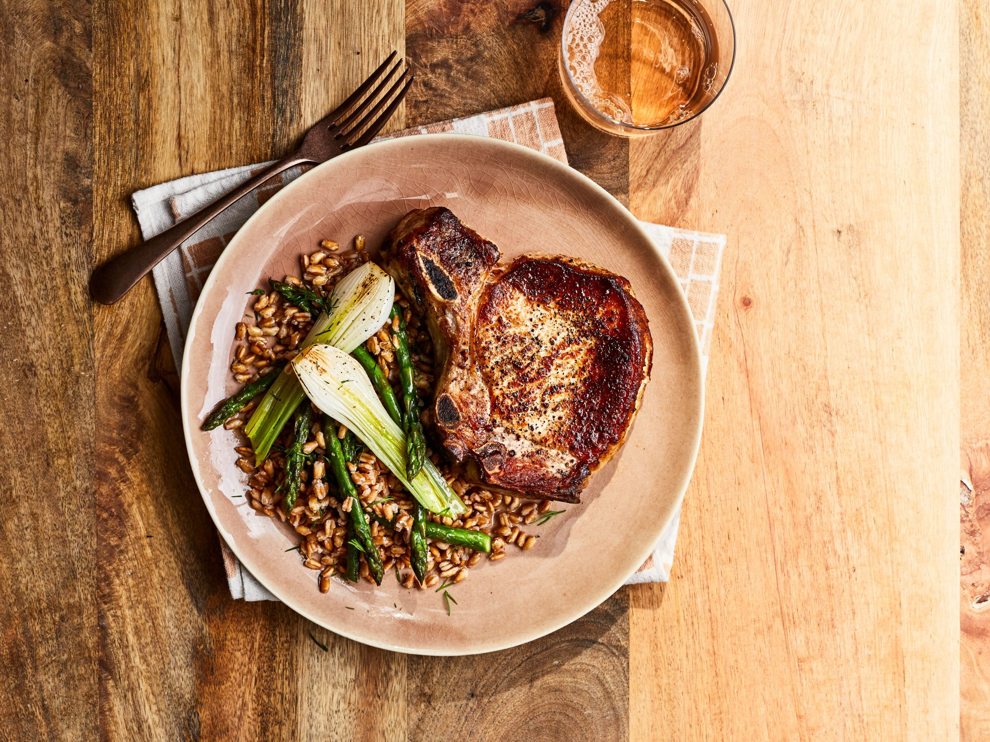Pork Chops with Spring Onions, Farro, and Asparagus