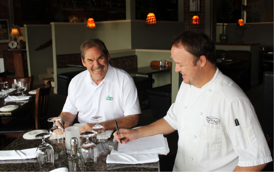 Bobby Williams, left, and Mike Davis, right, sit down at Terra in West Columbia to plan out Christmas Eve dinner together. Photo courtesy of Katie Alice Walker.