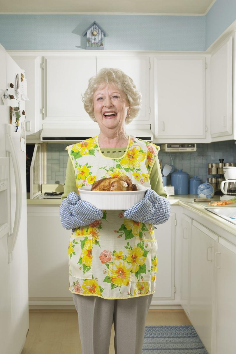 grandmother in apron cooking