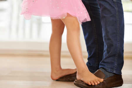 girl dancing with dad