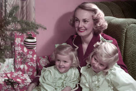 mother and daugters christmas at tree