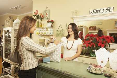 Woman making purchase at boutique