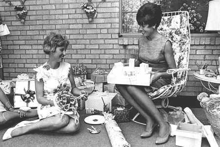 Woman Accepting Gift at a Party