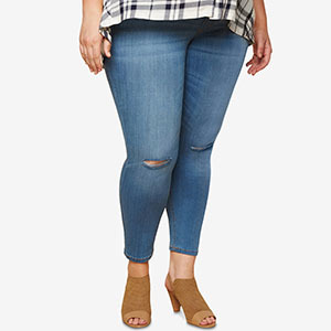 woman in light blue jeans with hole in knee from Macys photo