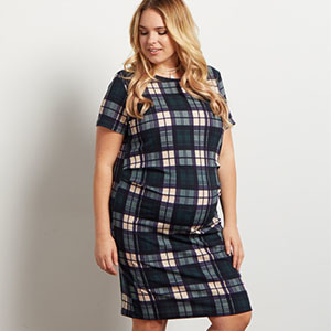 preganant woman in flannel dress from pink blush maternity photo