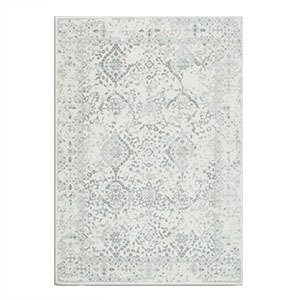 White and gray World Market area rug featuring a traditional pattern. photo