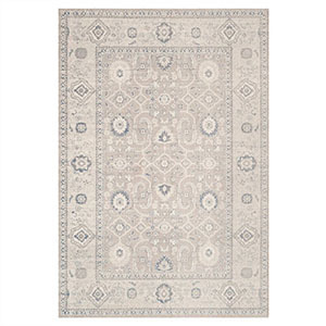 Taupe and ivory One Kings Lane area rug with slight pops of blue. photo