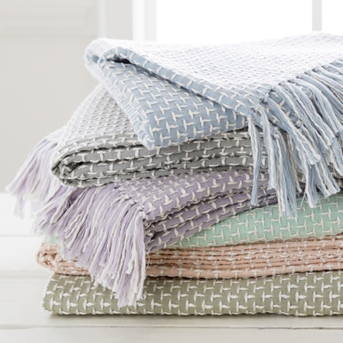 Overstock knit throw blankets in various pastel colors photo