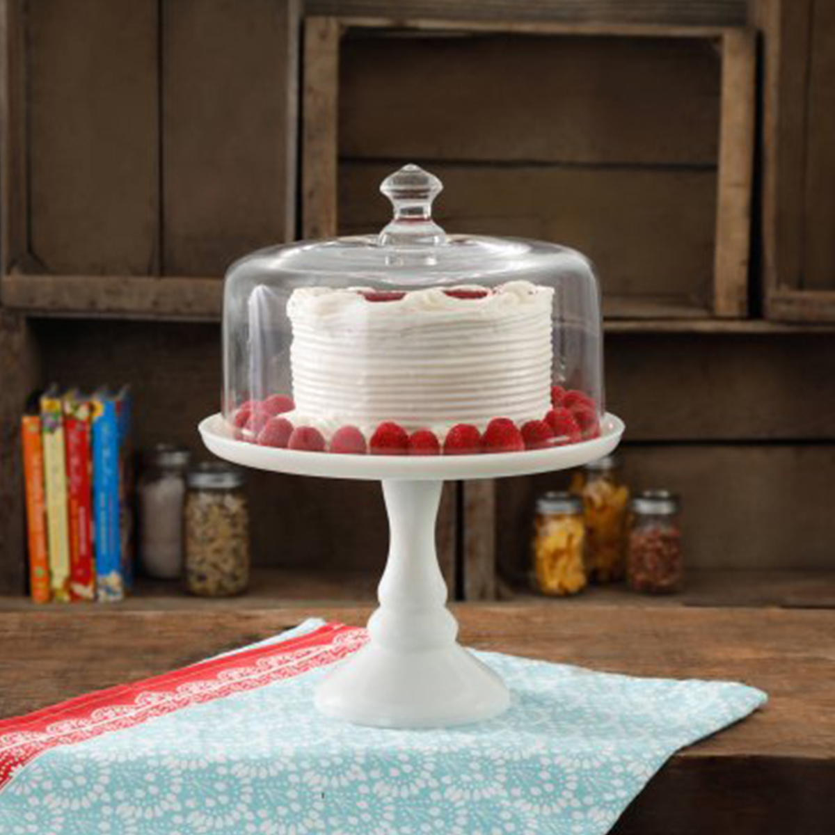 White cake stand with glass cover photo