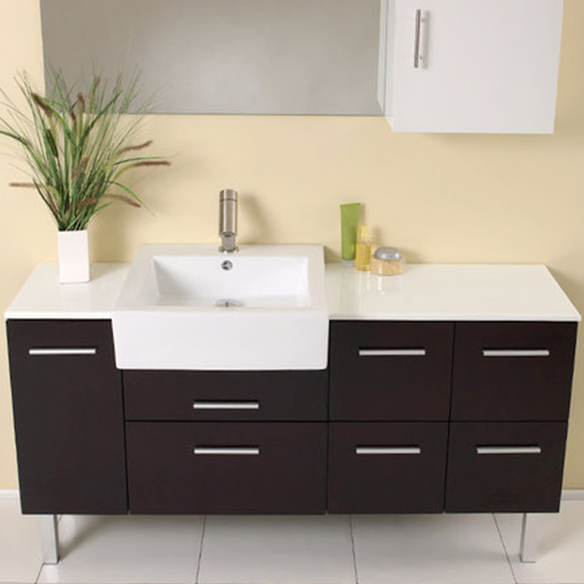 Freestanding bathroom vanity with brown base and white rectangular sink photo