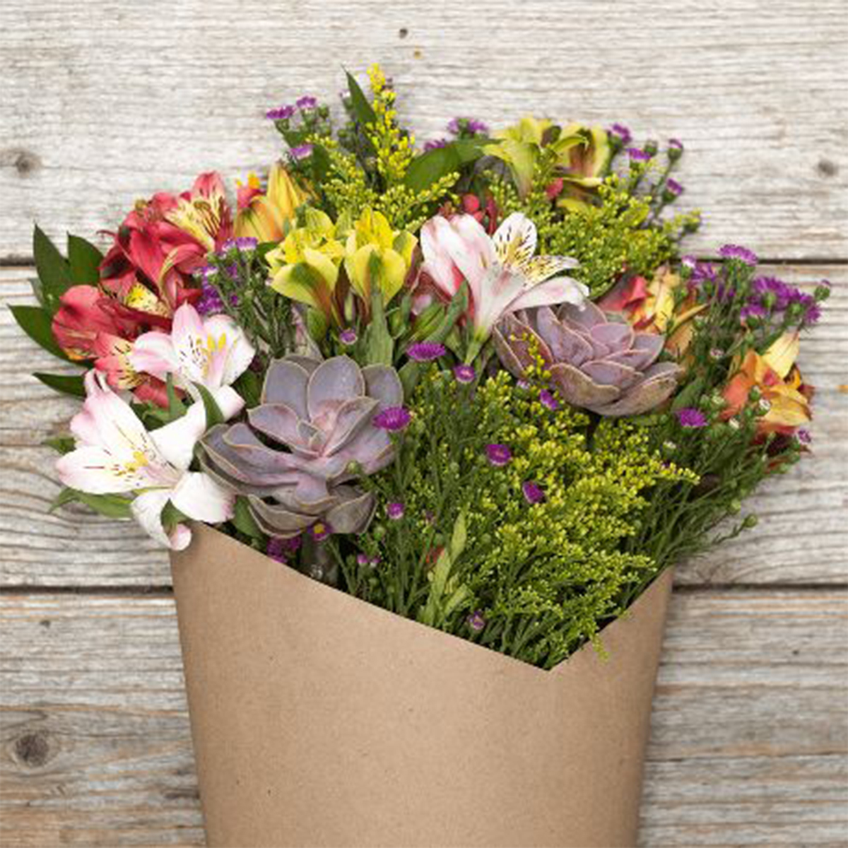 Bouquet of flowers featuring succulents and lilies photo