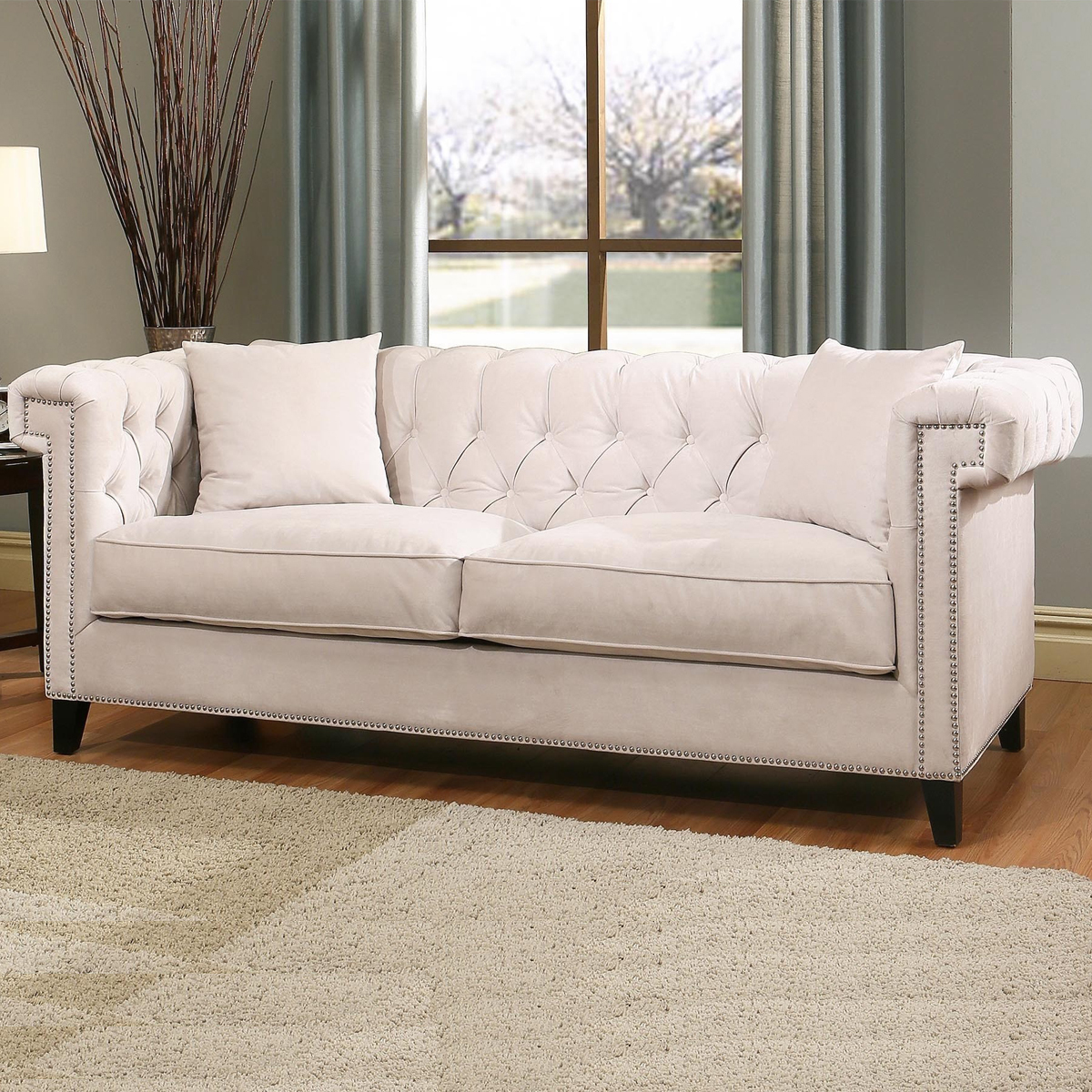 Ivory velvet love seat with two matching throw pillows. photo