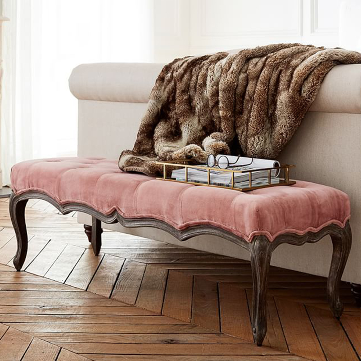 Vintage-inspired bench with tufted pink velvet. photo