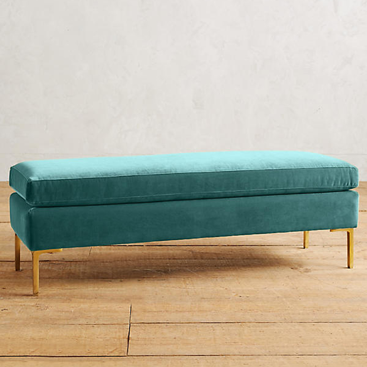 Teal vlevet bench with gold legs. photo