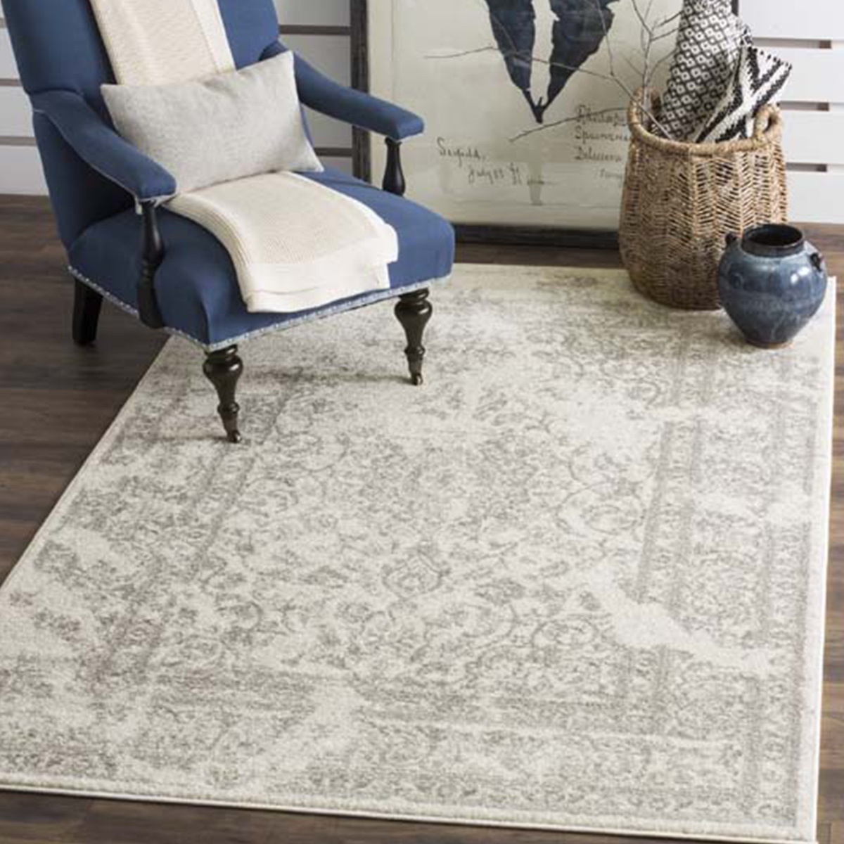 Neutral ivory and silver rug with a vintage-inspired motif. photo