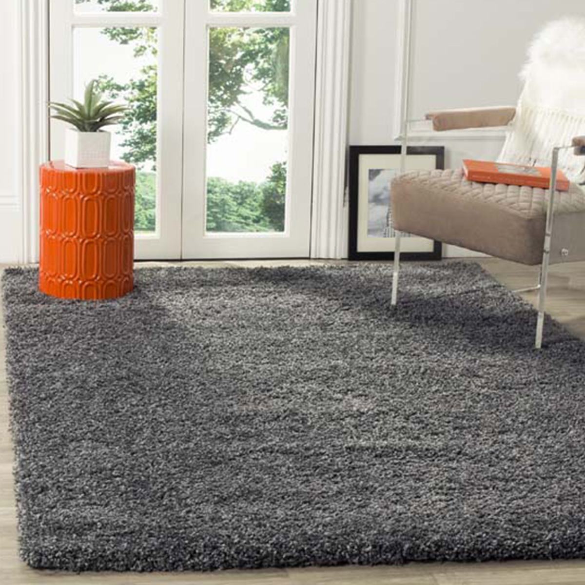 Dark gray shag rug that is resilient in high-traffic areas. photo