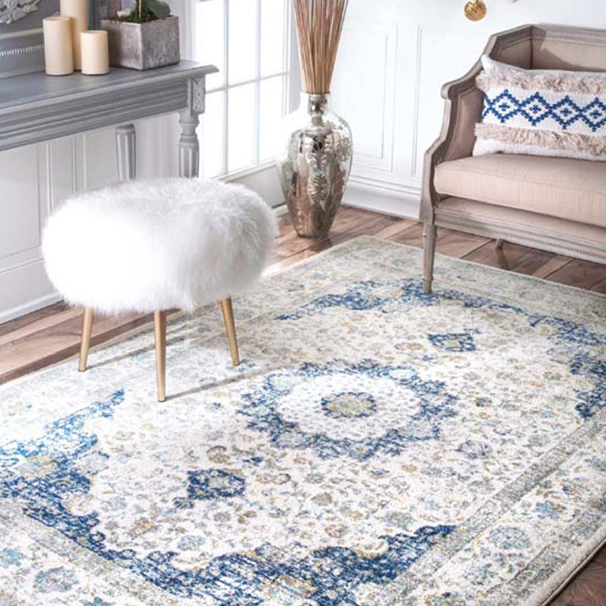 Persian-style rug with a blue, gray, and ivory pattern that is super soft and durable. photo