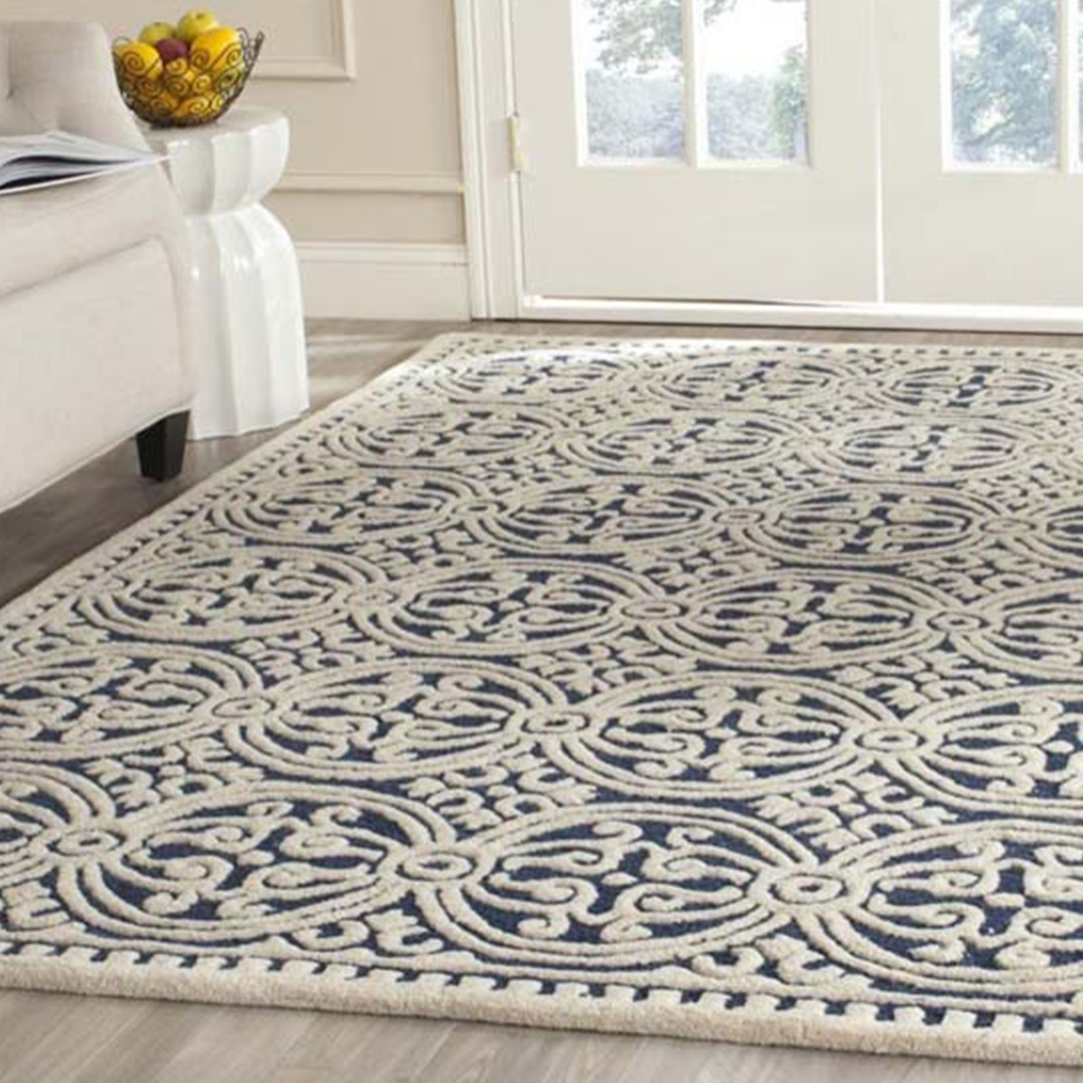 Moroccan inspired wool rug with a navy blue and white geometric pattern. photo