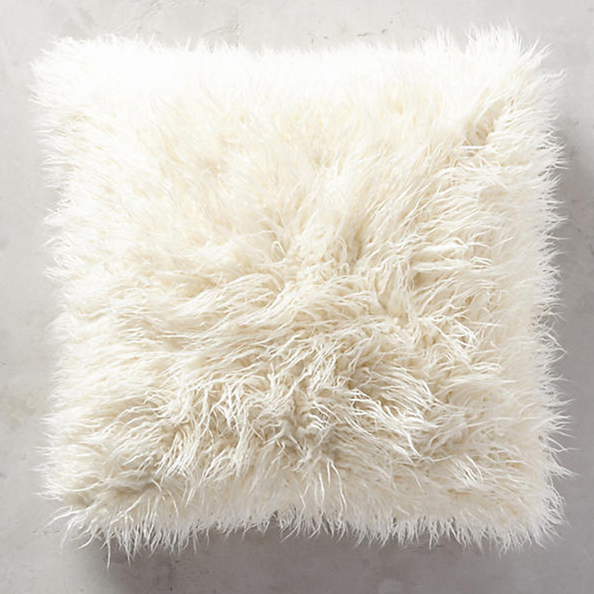Soft shag pillow in an ivory hue photo