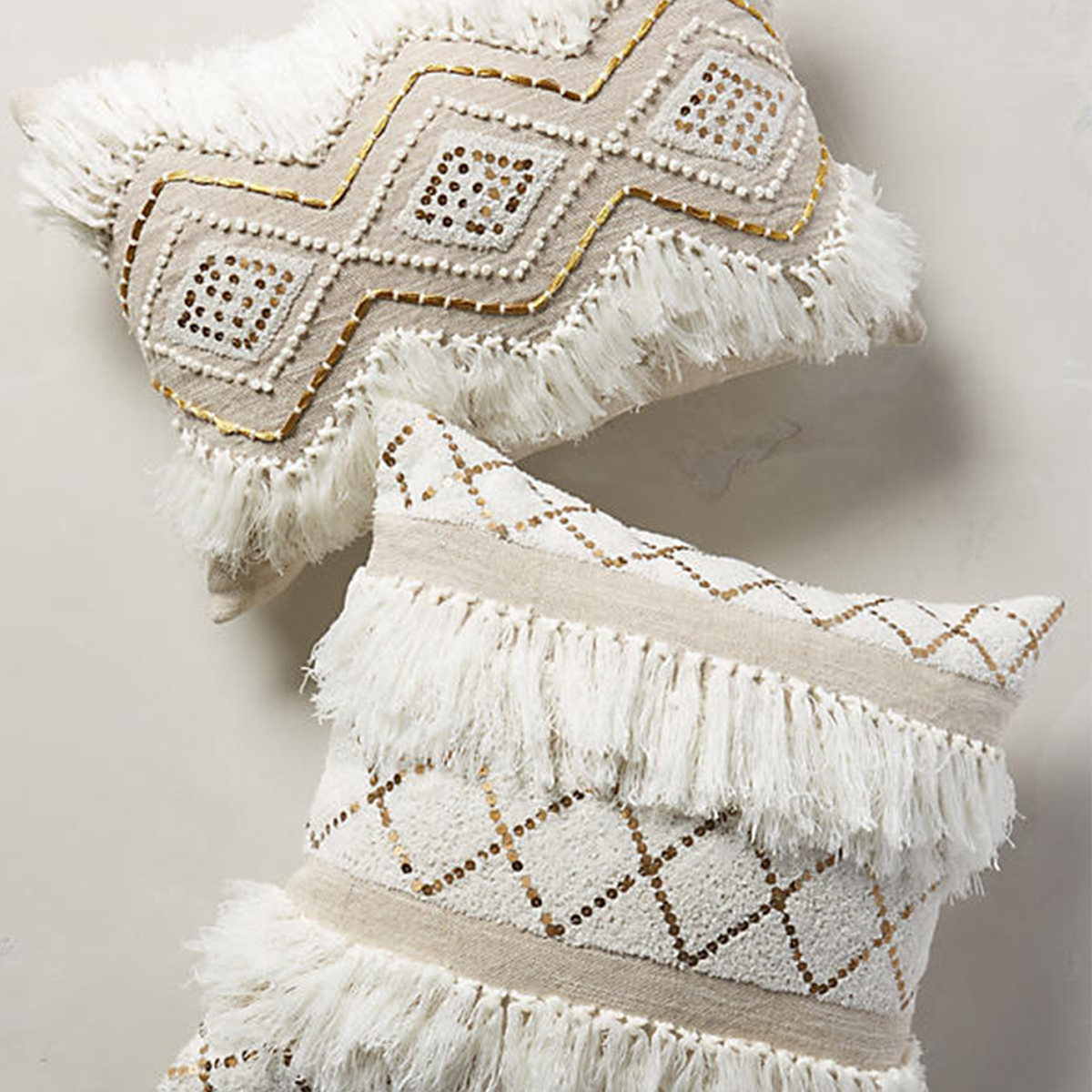 Moroccan-inspired pillows with jute and linen fronts and metallic accents. photo
