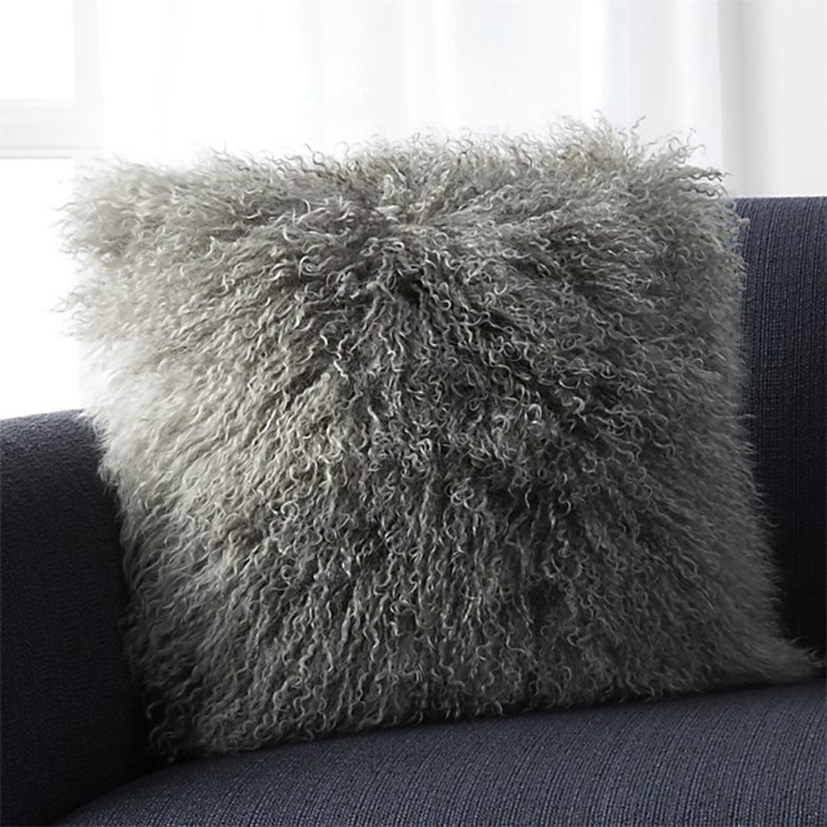 Oversized pillow with gray shag fabric photo