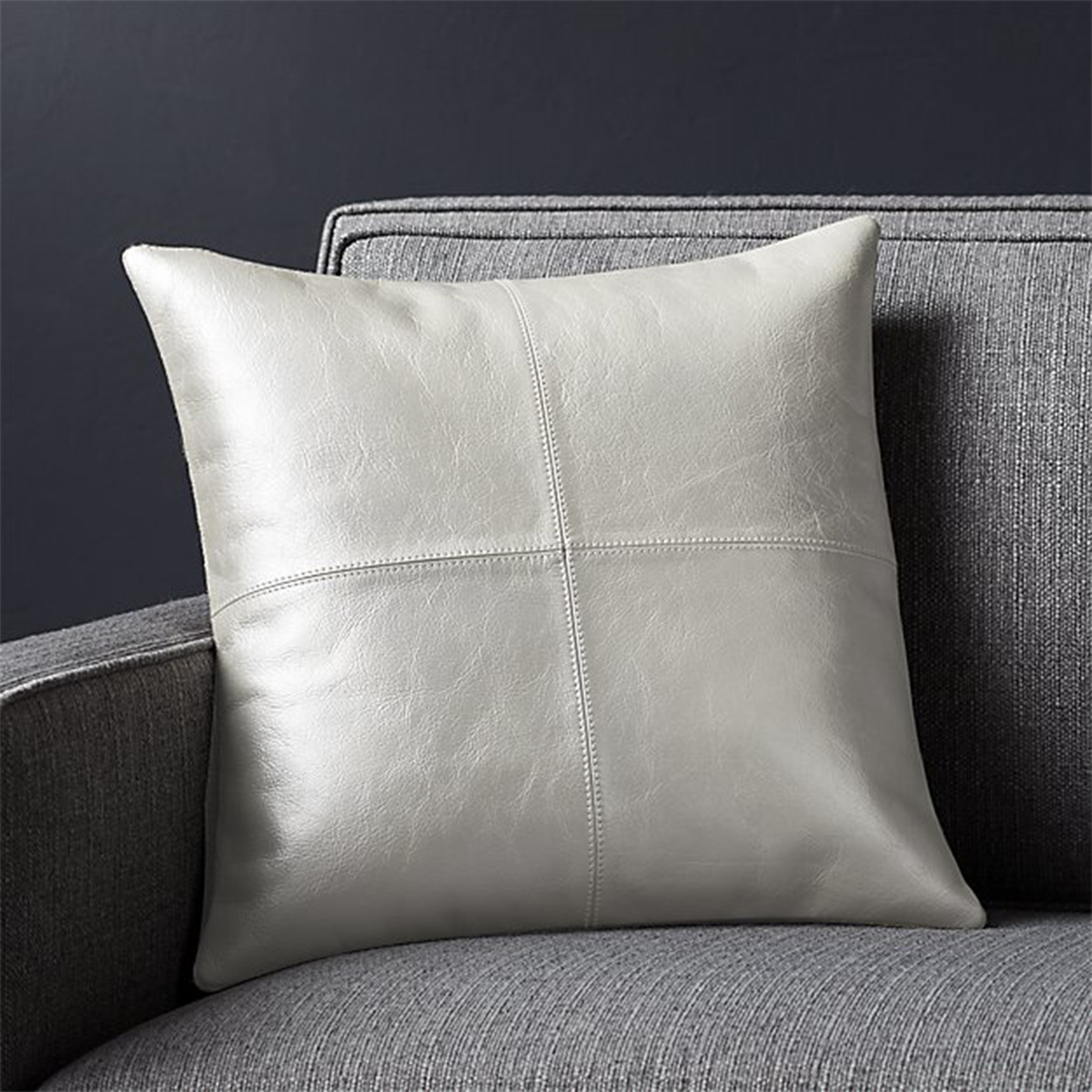 Leather decorative pillow in a metallic silver color photo