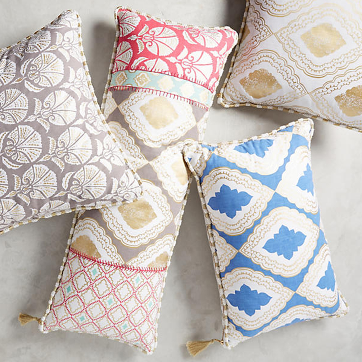 Colorful patterned throw pillows with fun gold tassels. photo