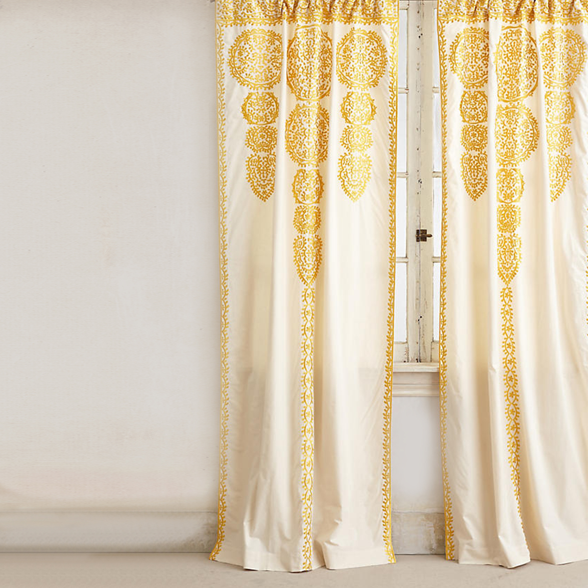 yellow embroidered curtains with unique pattern. photo
